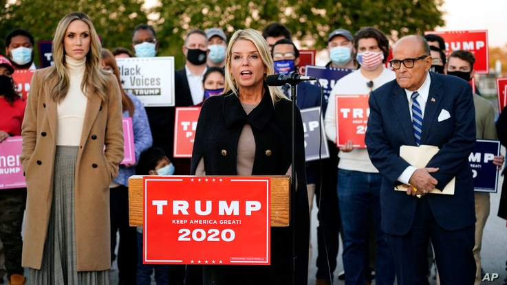 Former Florida Attorney General Pam Bondi, center, speaks during a news conference on legal challenges to vote counting in…