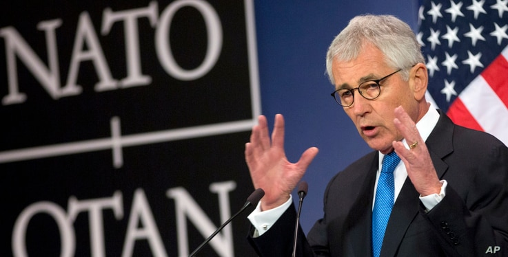 U.S. Secretary of Defense Chuck Hagel speaks during a media conference at NATO headquarters in Brussels on Thursday, Feb. 5,…