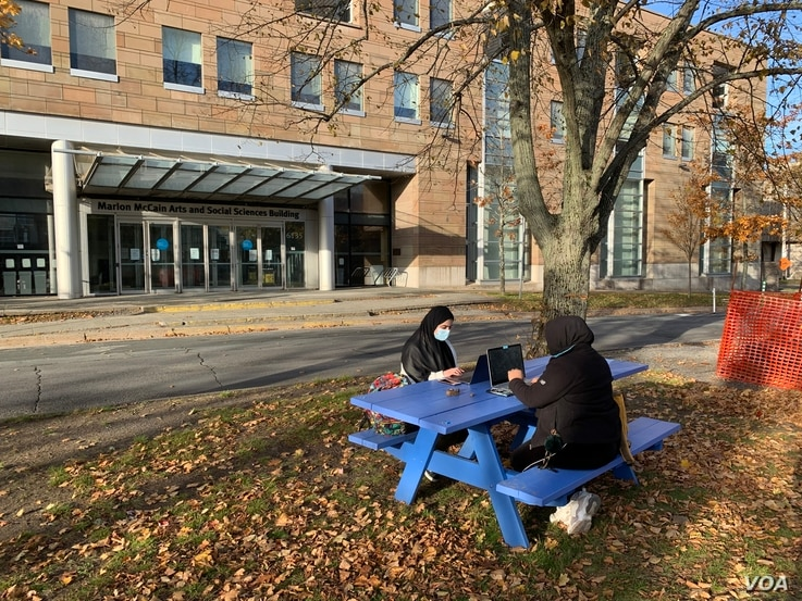 Students enjoy the last days of nice weather on Dalhousie University campus in Halifax, Canada.