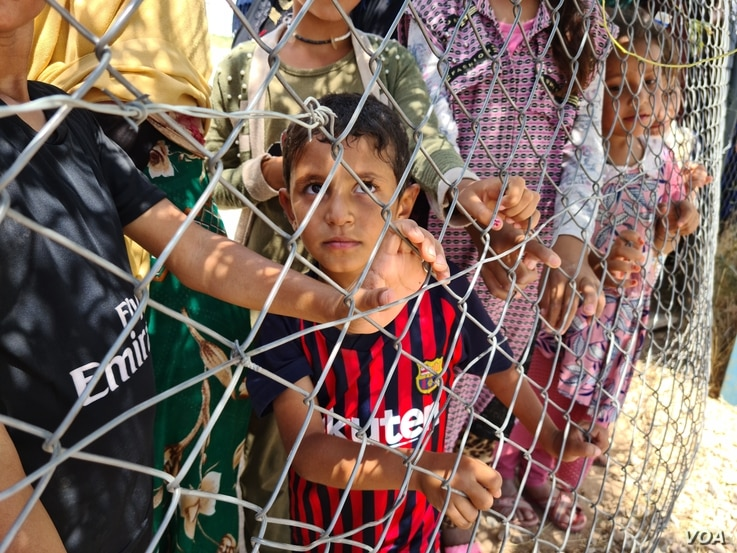 Kid: Aid groups say roughly two to three million people remain displaced in Iraq, and as the country moves to close camps, many have nowhere to go on July 25, 2020 in Hassan Sham, Iraq. (Halan Akoiy/VOA)