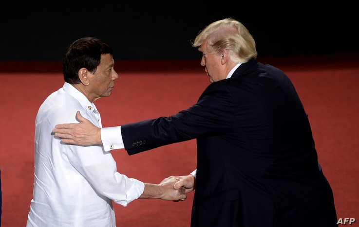 FILE - Philippine President Rodrigo Duterte shakes hands with U.S. President Donald Trump (R) during an Association of Southeast Asian Nations (ASEAN) Summit at the Cultural Center of the Philippines, in Manila, Nov. 13, 2017.