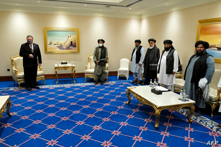 U.S. Secretary of State Mike Pompeo (L) meets with the Taliban's Mullah Abdul Ghani Baradar (C-R) and members of his negotiating team, in the Qatari capital Doha, Nov. 21, 2020.