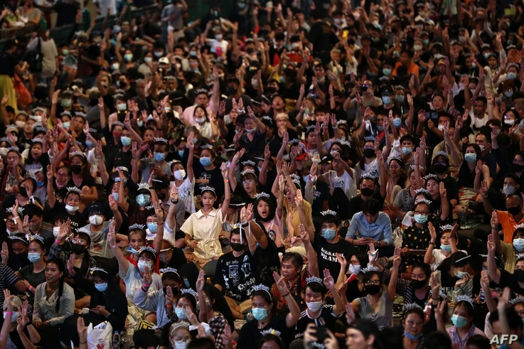 Pro-democracy protesters flash the three-finger salute during a 'Bad Student' rally in Bangkok, Thailand, Nov. 21, 2020.