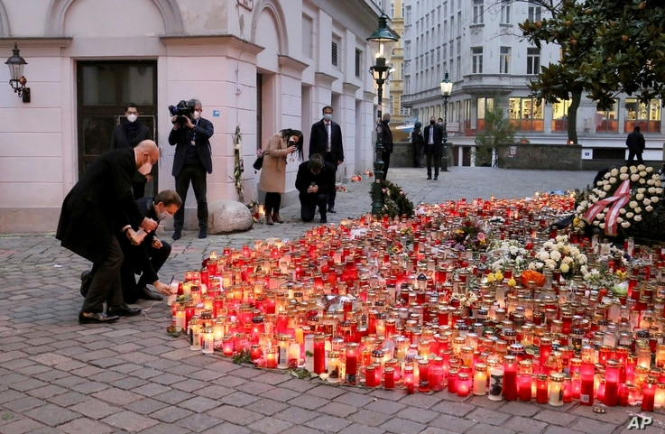 President of the European Council Charles Michel, left, and Austrian Chancellor Sebastian Kurz, right, pay respect to those killed in the recent terror attack, in Vienna, Austria.