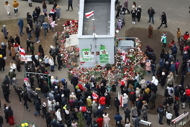 People gather to honor 31-year-old Raman Bandarenka, who died at a Minsk hospital after several hours of surgery due to serious injuries in Minsk, Belarus, Nov. 13, 2020.