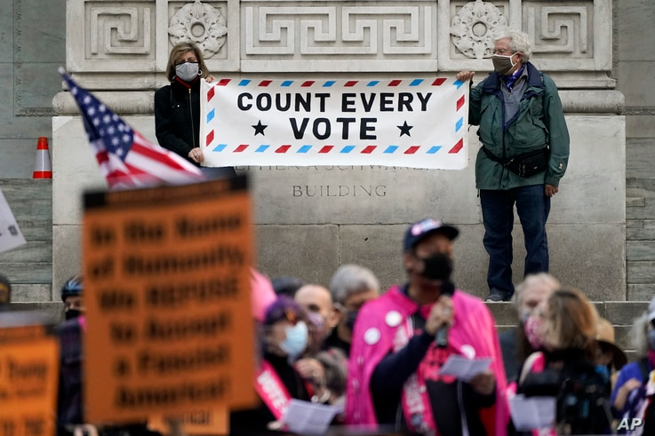 Demonstrators rally outside the New York Public Library calling for the counting of all votes cast in the U.S. presidential election, in New York City, Nov. 4, 2020.