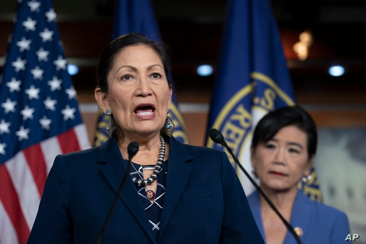FILE - Congresswoman Deb Haaland, Native American Caucus co-chair, joined at right by Congresswoman Judy Chu, chair of the Congressional Asian Pacific American Caucus, speaks to reporters on Capitol Hill in Washington, March 5, 2020.