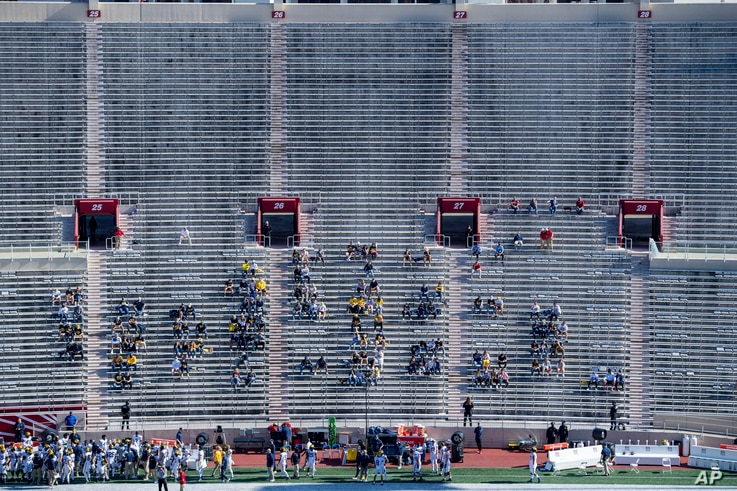 Michigan University fans watch during the first half of an NCAA college football game against Indiana at Memorial Stadium, Nov. 7, 2020, in Bloomington, Indiana.