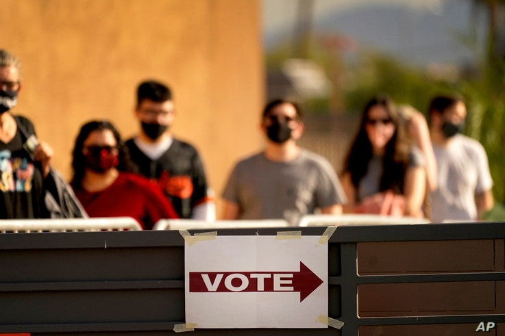 Voters stand in line outside a polling station on Election Day, in Mesa, Arizona, Nov. 3, 2020.