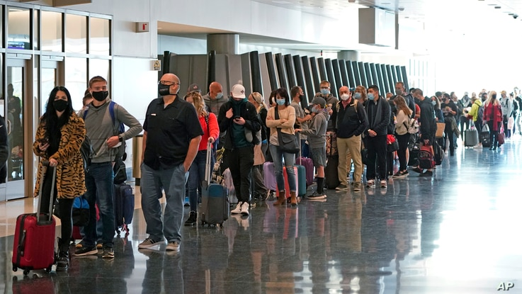 Air travelers line up to go through a security checkpoint at Salt Lake City International Airport in Salt Lake City, Utah.