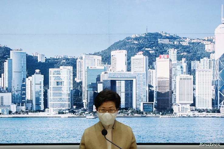 Hong Kong's Chief Executive Carrie Lam holds a news conference after four pro-democratic legislators were disqualified when China passed a new dissent resolution, in Hong Kong, Nov. 11, 2020.