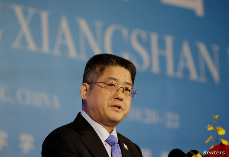 FILE - China's Vice Foreign Minister Le Yucheng speaks at a forum in Beijing, China, Oct. 22, 2019.