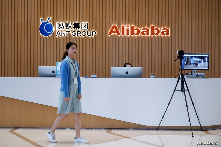 A logo of Ant Group is pictured at the headquarters of the company, an affiliate of Alibaba, in Hangzhou, Zhejiang province, China, Oct. 29, 2020. REUTERS/Aly Song/File Photo
