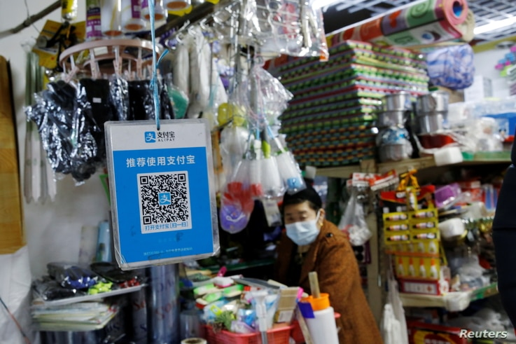 A QR code of digital payment device Alipay by Ant Group, an affiliate of Alibaba Group Holding, is seen at a grocery shop inside a market, in Beijing, China, Nov. 2, 2020.