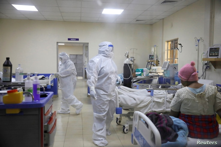 Medical staff dressed in protective suits treat coronavirus disease patients at the COVID-19 ICU of Machakos Level 5 Hospital, in Machakos, Kenya, Oct. 28, 2020.
