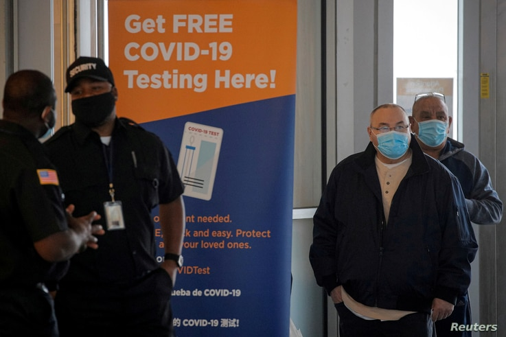 People stand in line to be tested for the coronavirus disease (COVID-19), at a test center at the Staten Island Ferry Terminal in Staten Island, New York, Nov. 12, 2020.