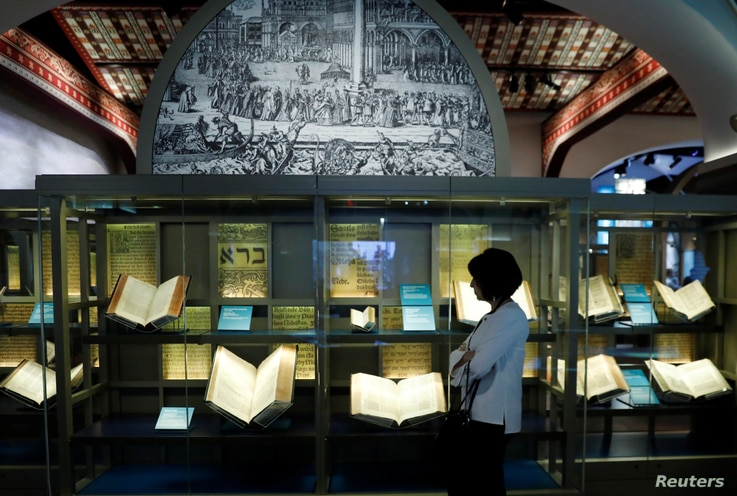 FILE - A visitor looks at various Bibles during a preview at the Museum of the Bible in Washington, D.C., Nov. 14, 2017.