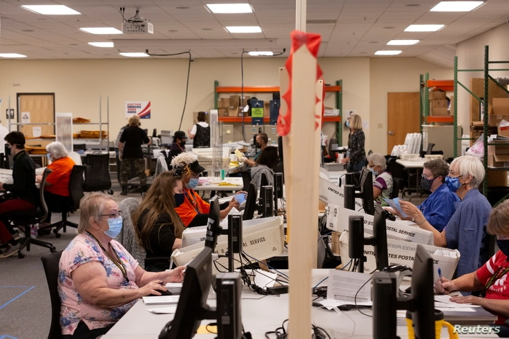 Early voting and absentee ballots are processed ahead of the upcoming presidential election in Tucson, Arizona, Oct. 31, 2020.