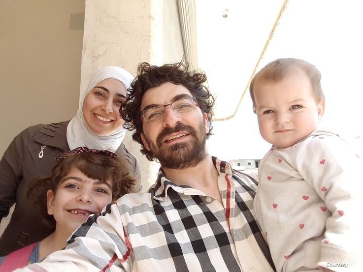 Maimouna al-Ammar, her husband and two daughters pose in a photo taken in 2018 in northern Syria after their displacement from eastern Ghouta near Damascus following a deal between the Syrian government and rebel groups. (Courtesy: Maimouna al-Ammar)