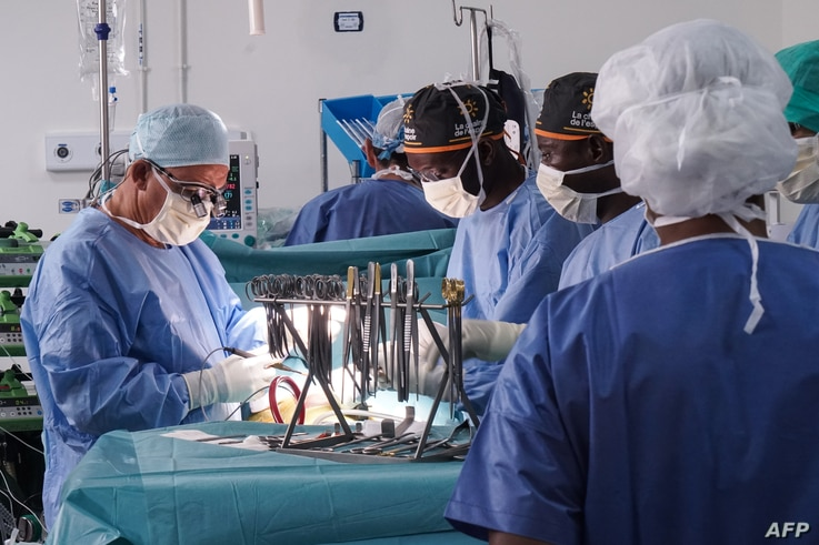 French doctor Olivier Baron, a thoracic and cardiovascular surgeon from the Nantes University Hospital, assisted by Malian…