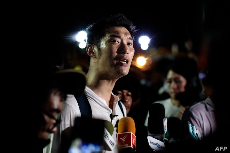 Thai prominent opposition figure Thanathorn Juangroongruangkit addresses the media as he attends a pro-democracy rally in…
