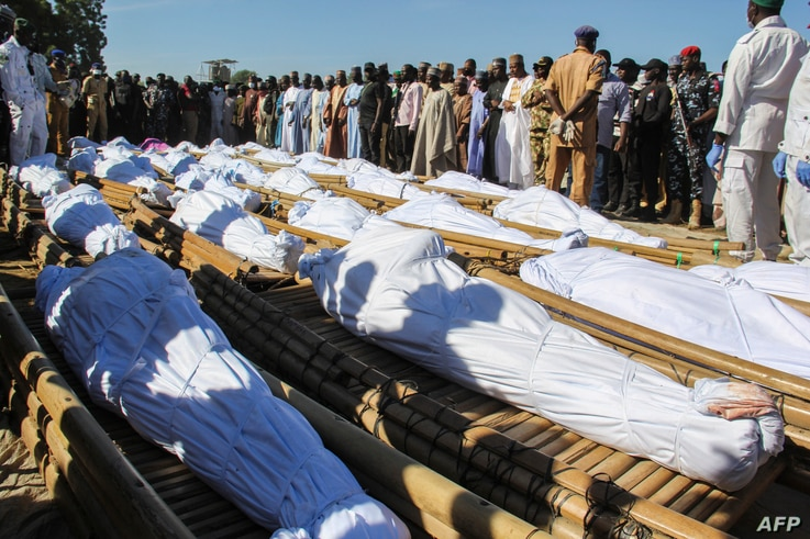 Mourners attend the funeral of 43 farm workers in Zabarmari, about 20km from Maiduguri, Nigeria, on November 29, 2020 after…