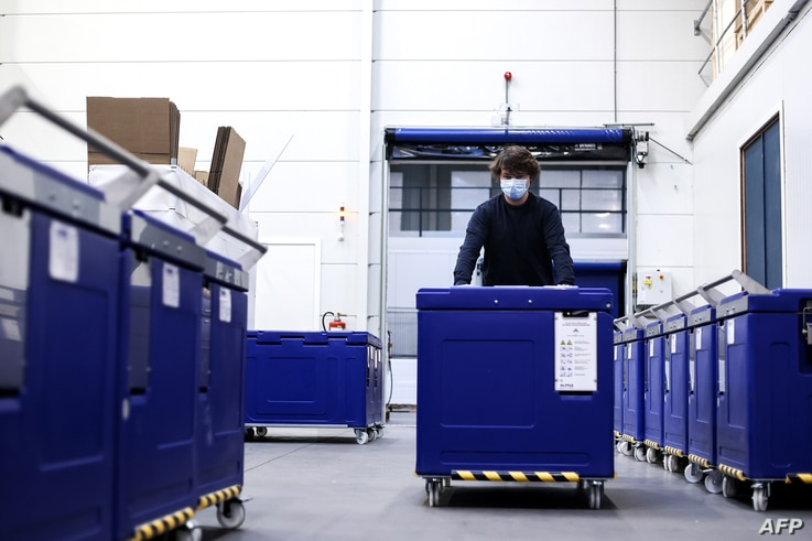 An employee of Cryonomic, a Belgium's company producing dry ice machines and containers which will be used for Covid-19…