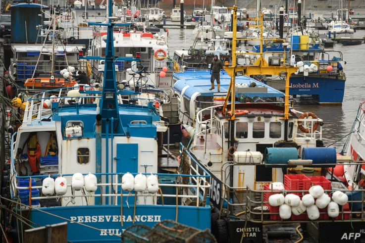 Fishing boats are moored adjacent to the South Pier of Bridlington Harbour fishing port in Bridlington, north east England on...