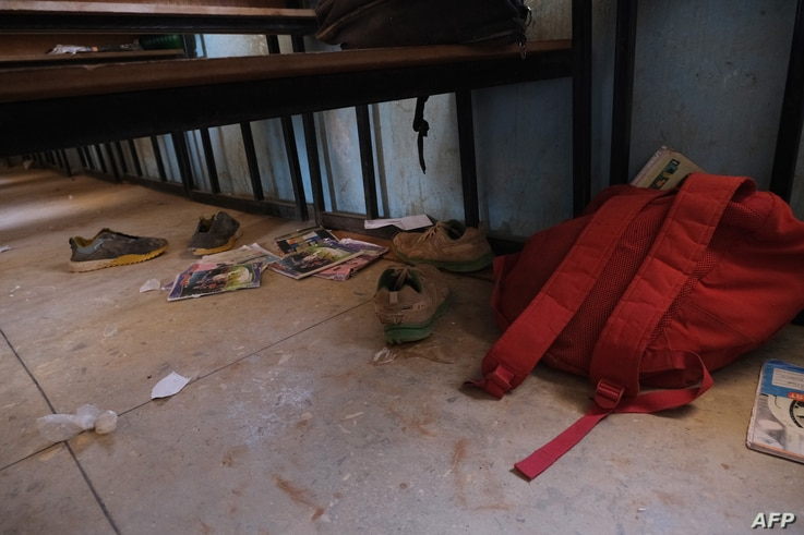 School bags and wares belonging to pupils at the Government Science school are seen on the floor where gunmen abducted students…