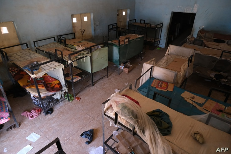 An empty dormitory full of wares of schoolboys is seen after gunmen abducted students at the Government Science school in…