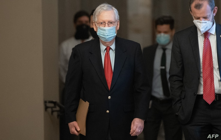US Senate Majority Leader Mitch McConnell, Republican of Kentucky, walks to his office from the Senate Floor at the US Capitol…