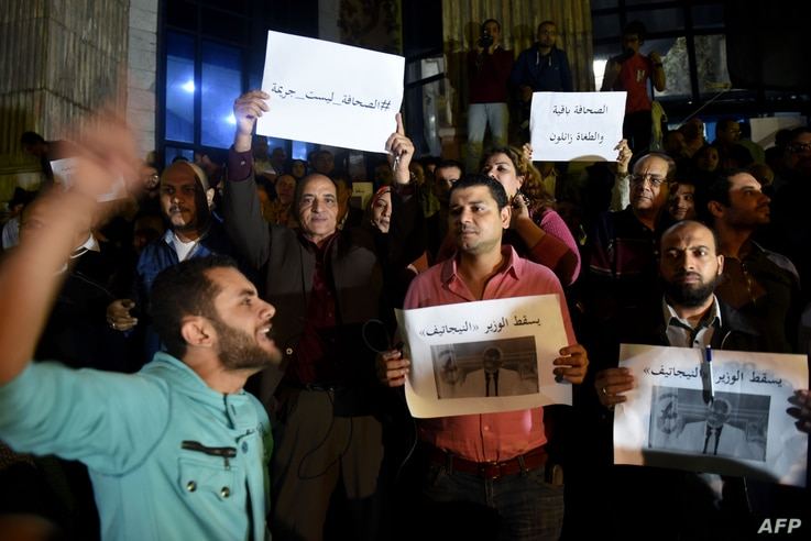 Journalists chant slogans as they gather in front of the Journalists' Syndicate in Cairo on November 19, 2016, to protest…