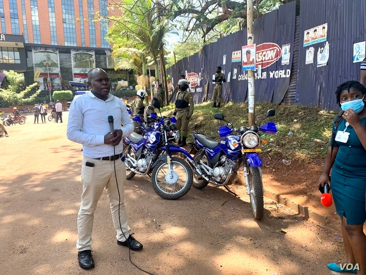 A Ugandan journalist reports live from a scene where journalist walked out in protest of security brutality