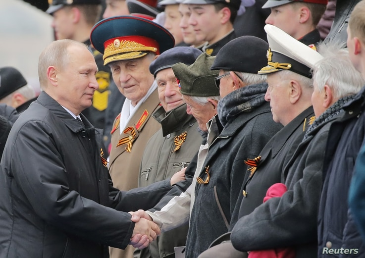 Moscow - Russia - 09/05/2017 - Russian President Vladimir Putin shakes hands with veterans after the the Victory Day military…
