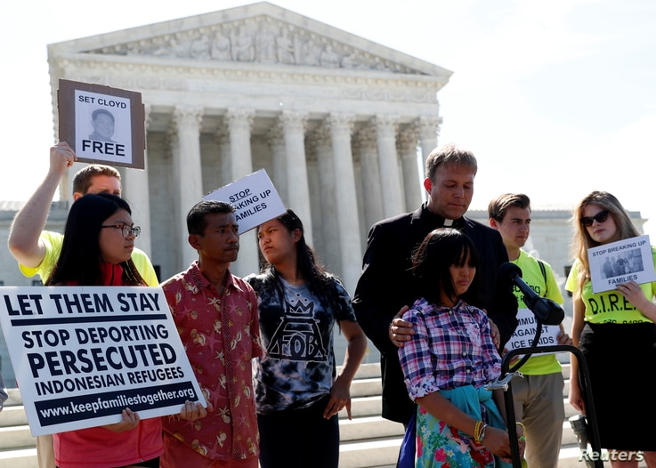 Naomi Lien is comforted by Pastor Seth Kaper-Dale as she they react outside the U.S. Supreme Court after the Court upheld U…