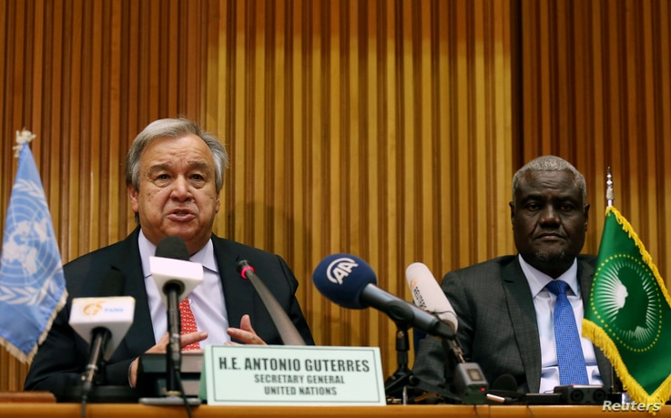 U.N. Secretary General Antonio Guterres (L) flanked by the African Union Commission Chairperson Moussa Faki Mahamat addresses a…
