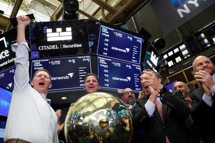 SolarWinds Corp. CEO Kevin Thompson celebrates his company's IPO on the floor of the New York Stock Exchange (NYSE) in New York…