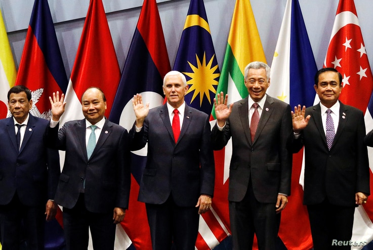 U.S. Vice President Mike Pence poses for a group photo with Philippine President Rodrigo Duterte, Vietnam's Prime Minister…