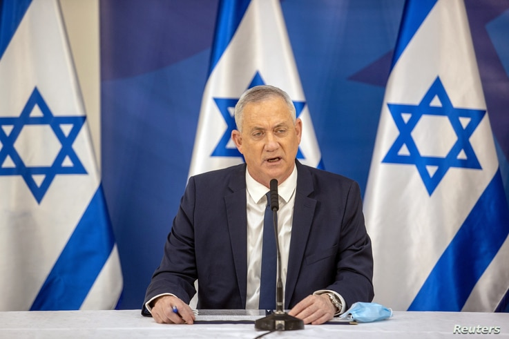 Israel's Alternate Prime Minister and Defence Minister Benny Gantz issues a statement at the Israeli Defense Ministry in Tel…