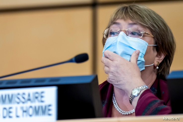 United Nations' High Commissioner for Human Rights Michelle Bachelet adjusts her mask during the opening of 45th session of the…