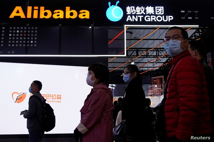Signs of Alibaba Group and Ant Group are seen during the World Internet Conference (WIC) in Wuzhen, Zhejiang province, China,…