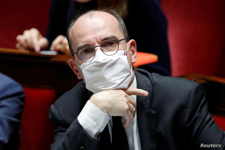 French Prime Minister Jean Castex, wearing a protective face mask, attends the questions to the government session at the…