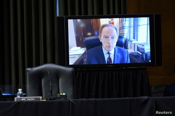 """Sen. Pat Toomey, R-Pa., speaks via video conference during a Senate Banking Committee hearing on """"The Quarterly CARES Act…"""