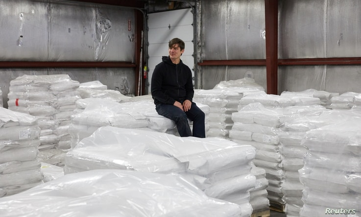 CEO and Founder of Eat Just Josh Tetrick sits on bags of plant protein at the Eat Just facility in Appleton, Minnesota, U.S.,…