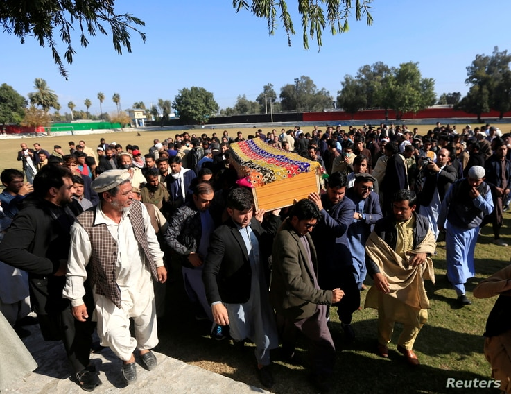 Afghan men carry the coffin of journalist Malalai Maiwand, who was shot and killed by unknown gunmen in Jalalabad, Afghanistan, Dec. 10, 2020.