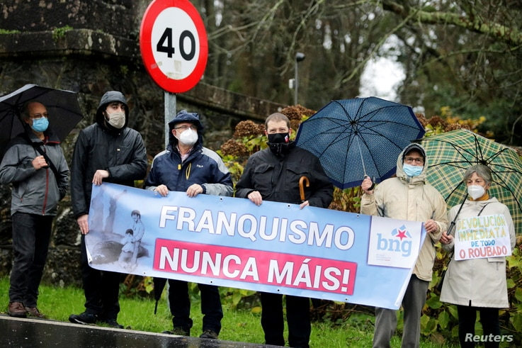 People demonstrate outside Pazo de Meiras, former Spanish dictator Francisco Franco's summer palace, which is being handed over by Franco's heirs to the Spanish state in Sada, northwestern Spain, Dec. 10, 2020.