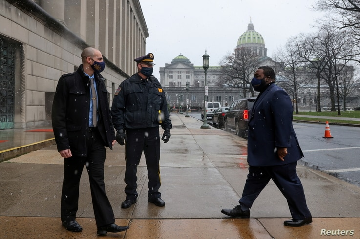 Electoral College member Pennsylvania State Representative Jordan Harris (D-Philadelphia) arrives at an entrance secured by…