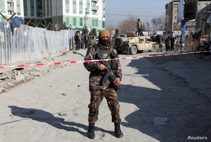 An Afghan security officer stands guard at the site of a bomb blast in Kabul, Afghanistan December 15, 2020. REUTERS/Omar…