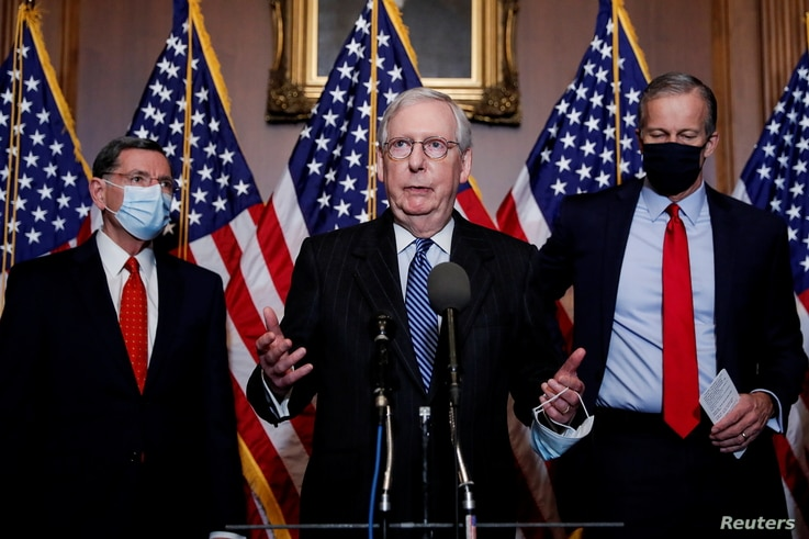 U.S. Senate Majority Leader Mitch McConnell (R-KY) is flanked by Senators John Barrasso R-WY) and John Thune (R-SD)  as he…