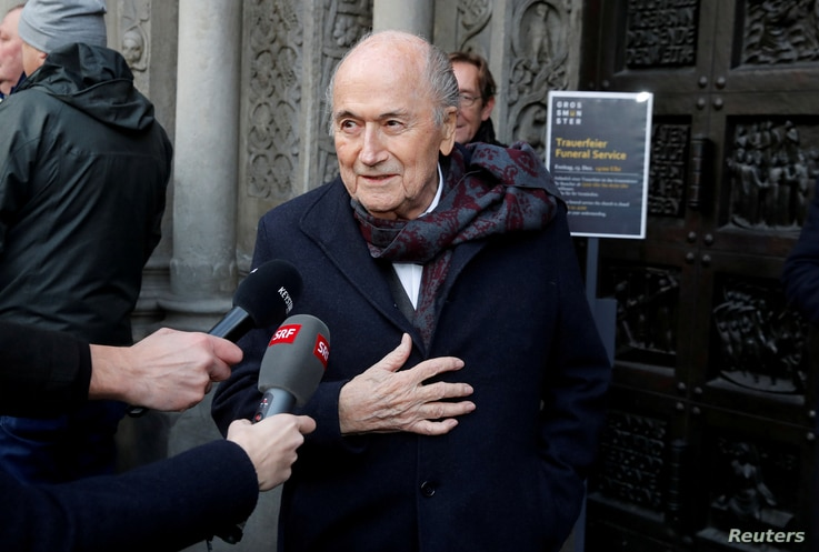 FILE PHOTO: Former FIFA president Sepp Blatter talks to the media as he arrives before a commemoration service for the former…